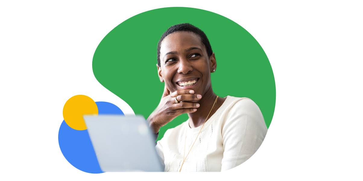 Woman smiling next to a laptop