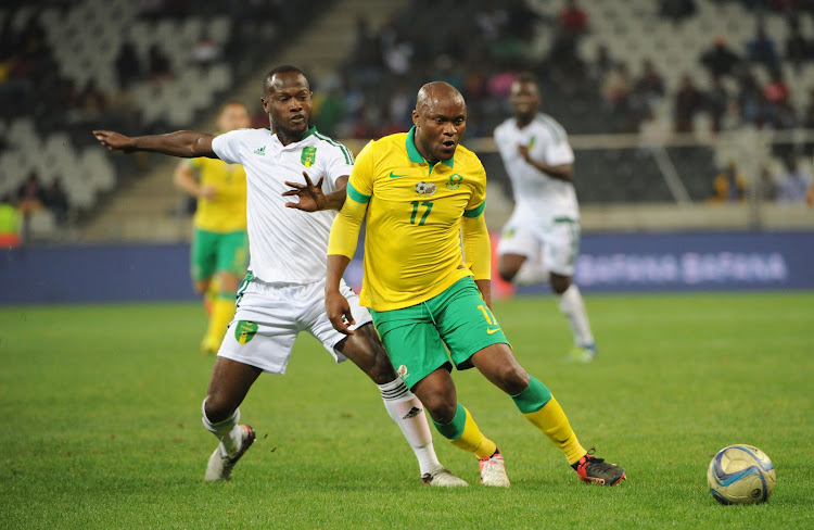 Tokelo Rantie of South Africa is challenged by Khassa Camara of Mauritania during the AFCON Qualifier match between South Africa and Mauritania 02 September 2016 at Mbombela Stadium.