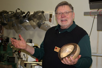 Photo: Dick Webster happily describes his spalted-maple, natural-edge bowl.