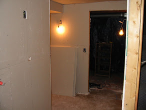 Photo: Coming down and around from stairs (far right). To the left is the theater. Laundry room straight ahead.