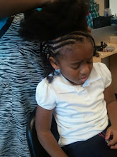 Photo: Kaleya getting her hair done. Not looking to happy.