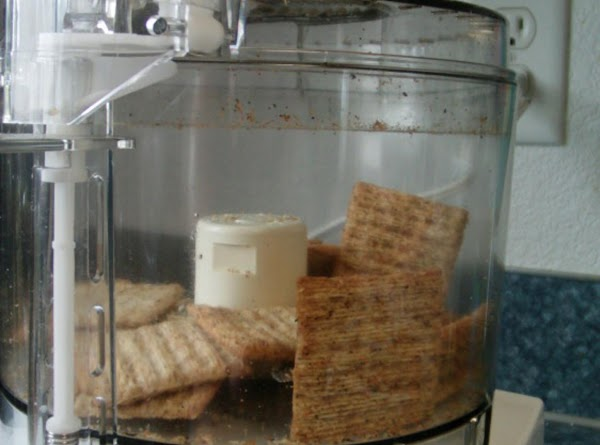 Pre-heat oven to 350. In a food processor add the Triscuits,red pepper flakes(optional) and...