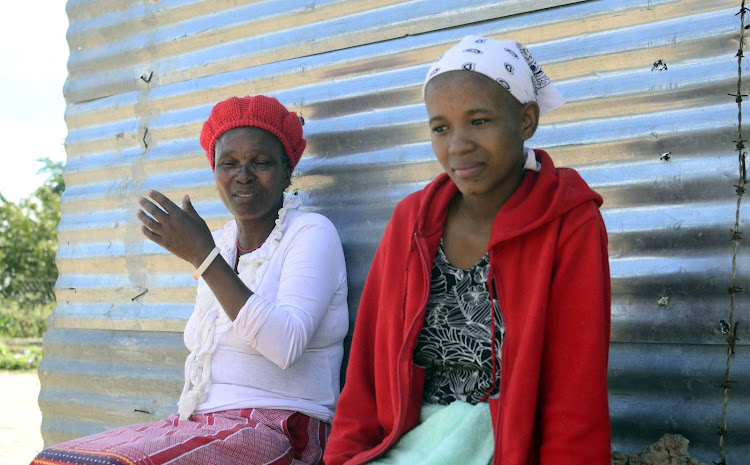 Rosina Mothibedi and her daughter Tshireletso Mothibedi at their home in Signal hill.