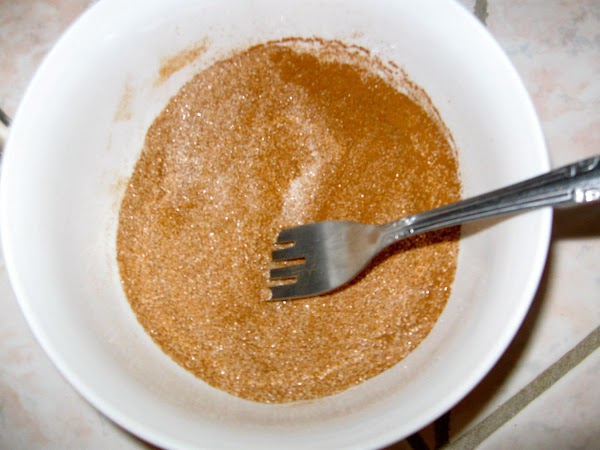 In a small bowl, combine sugar and cinnamon.