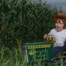 Yee Haw by Chris Cavallo - Babies & Children Child Portraits ( sky, cowboy, mountains, green, field, corn, tractor, cowboy hat, boots, white tshirt, jeans,  )