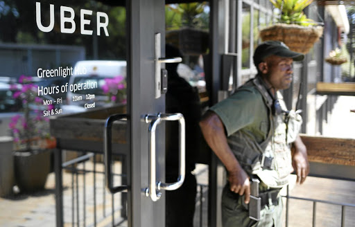 On guard: A private security guard stands outside Uber's Johannesburg offices. Uber and Taxify drivers have been under violent attack since the app-based services gained popularity. Picture: REUTERS