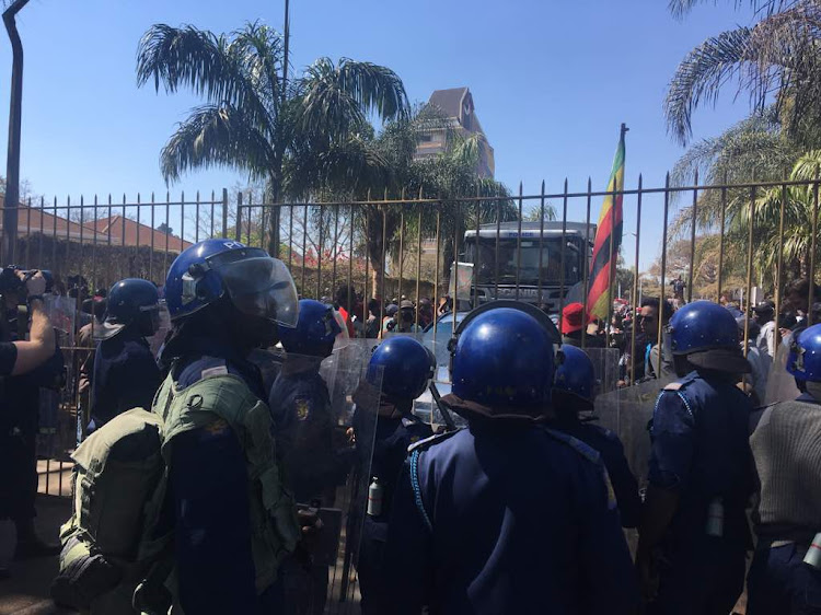 Pictures of MDC Alliance members demonstrating and demanding to be allowed into Zimbabwe's Electoral Commission command centre. Picture: RAY NDLOVU