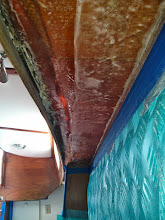Photo: new tabbing between underside of port deck and cabinet on port side