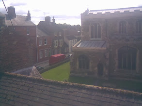Photo: The altar East end of the St. Marys Church with the single storey William Marwood cobblers cottage across the way.