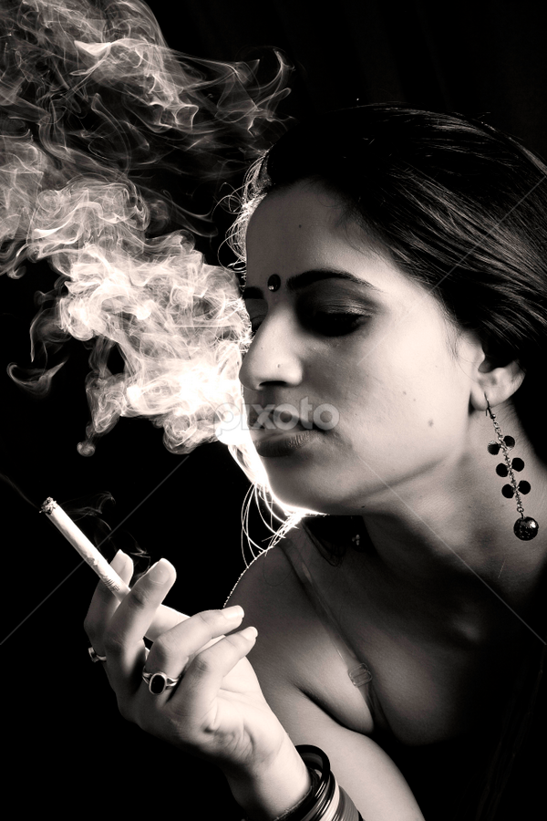 Smoking by Anurag Bhateja - People Portraits of Women