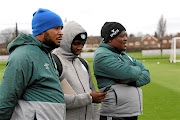 Bloemfontein Celtic MDC squad assistant coach  Ditheko Mototo, left, with team manager   Kgosi Molokwane and head coach Abram Nteo observing a  training session at Chadwell Heath, east of  London. The team are West Ham's guests.