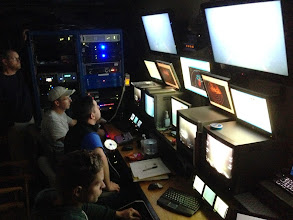 Photo: Scientists in the control room aboard the R/V Connecticut monitor camera feeds, navigation and sonar from the Kraken2 ROV (Image courtesy of Gulf of Maine Deep Sea Coral Science Team 2014/NURTEC-UConn/NOAA Fisheries/UMaine)