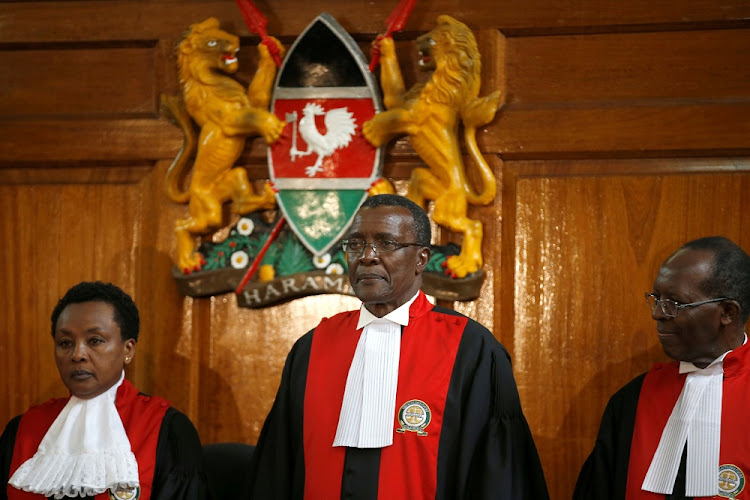 Kenyan Supreme Court Chief Justice David Maraga (centre) presides for the ruling that invalidated Uhuru Kenyatta's election win, in Nairobi, Kenya. Picture: REUTERS