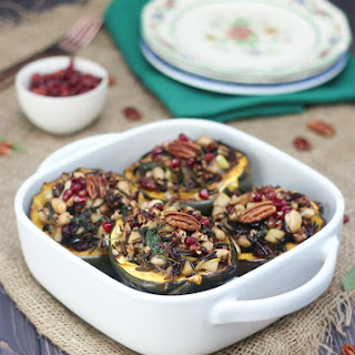 Vegan Stuffed Acorn Squash with Wild Rice, Apples and Caramelized Onions.