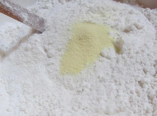 Measure out flour to medium size bowl, add baking powder, dry lemonade mix, lemon...