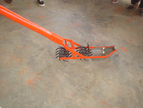 Photo: Mechanical weeder built in Cuba, introduced during workshop in Las Villas, Cuba. (4/05) (Photo by Rena Perez)