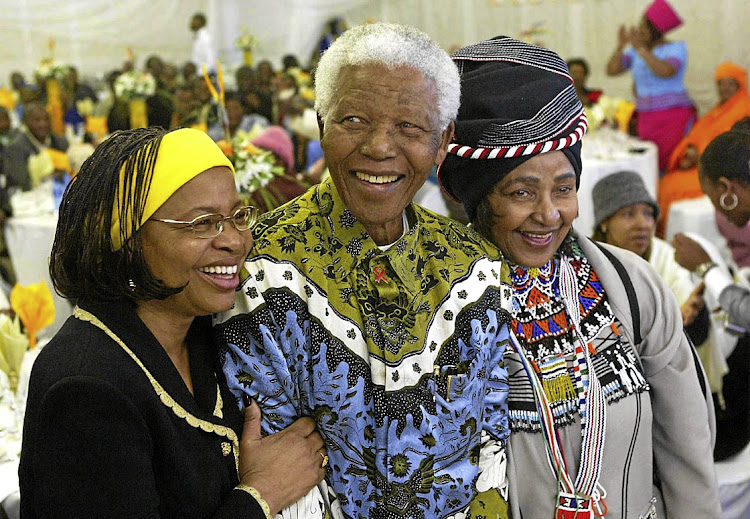 "Nelson Mandela celebrates his 86th birthday with his wife Graca Machel, left, and ex -wife Winnie Madikizela Mandela,right, in his rural home town of Qunu on July18 2004. Machel, who married Mandela in 1998, paid tribute to her predecessor in the years after her union. ""It's unfortunate that in our lives we don't interact very easily but I want to state very clearly that Winnie is my hero. Winnie is someone I respect highly,"" Machel once said."