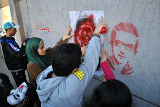 Photo: A stencil of some of the martyrs killed over the course of the year by the regime are honored in graffiti all over the walls of Cairo.