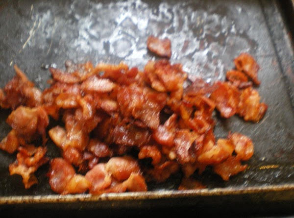 In a large skillet on medium low heat render bacon pieces in olive oil....
