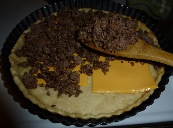 While pie crust is baking ground beef, drain, add about a half a package...