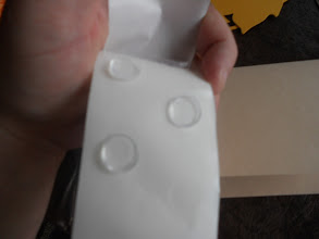 Photo: the glue spots come on a rolled strip and are spaced so you can get as few or as many as you need easily.