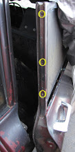 Photo: Location of screws for removable trim for side window glass panels