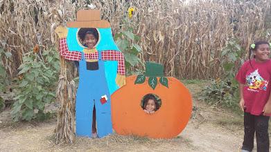 Photo: sisters as a farmer and a pumpkin