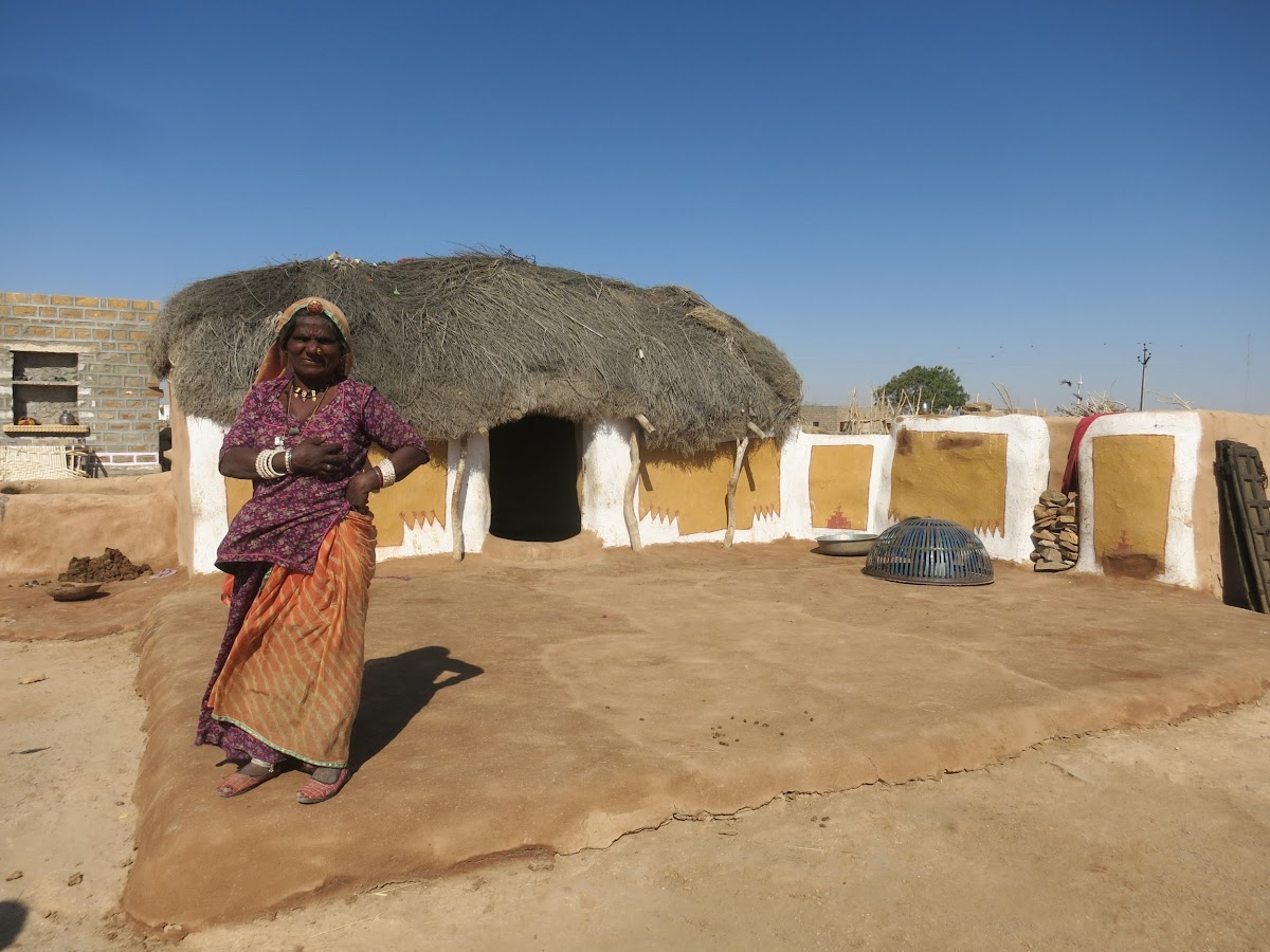 India. Rajasthan Thar Desert Camel Trek. Old lady by her summer house.