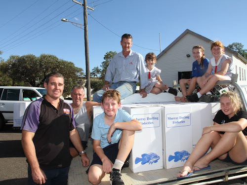 Fingerlings arrived on Monday from a Wagga hatchery to be met by, back, Narrabri Fishing Club publicity officer Jason Simpson, Emily Simpson, Ella Charlton, Jessie Simpson, front, Narrabri Fishing Club president Jamie Charlton, vice president Peter McCauley, Ben Allison and Bree Charlton.
