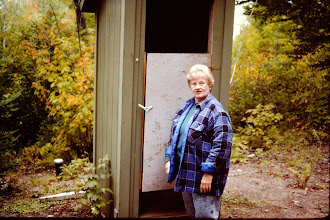 Photo: Pat and her improved outhouse door.