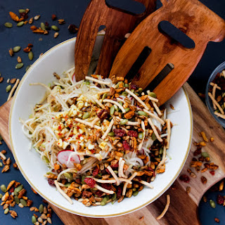 Russian Korean-style kohlrabi salad with apples, radishes and spicy salad topper