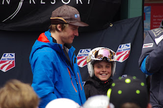 Photo: A young Park City Ski Team racer shares the stage with a former PC Ski Team racer.