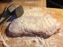 Coat your slab of beef with the flour mix.