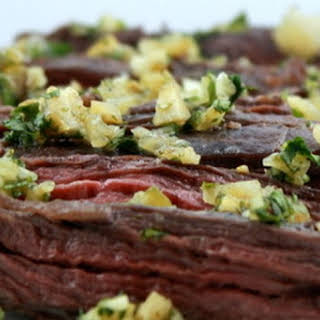 Broiled Marinated Skirt Steak with Cilantro and Preserved Lemon Gremolata.