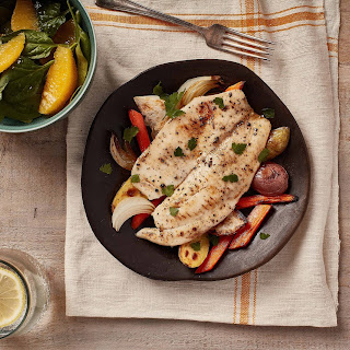 Oven Roasted Tilapia and Vegetables with Citrus Vinaigrette.