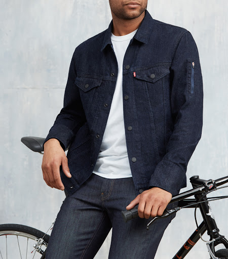 Cyclist wearing Levi's Commuter Trucker Jacket