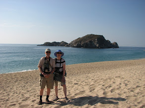 Photo: Two tourists. Many of these bays have these small islands.