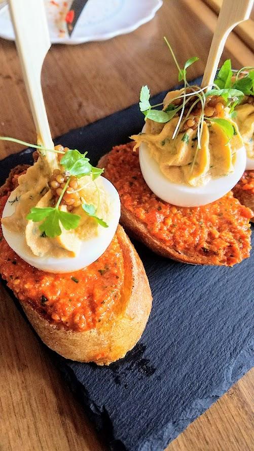 Pinxtos at Urdaneta: here you see Huevo Diablo, albacore tuna deviled egg, romesco, mustard seed caviar, toasted bread