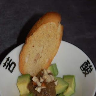 Avocado with Eggplant Caviar and Hazelnuts.