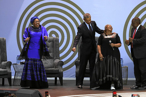 Madiba's widow Graca Machel, former US president Barack Obama and President Cyril Ramaphosa dance while jazz singer Thandiswa Mazwai sings at the 16th annual Nelson Mandela lecture at the Wanderers Criket Stadium in Johannesburg.