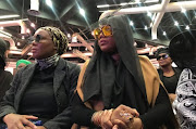 Lerato Sengadi seated next to her mom at Jabba's funeral in November last year.