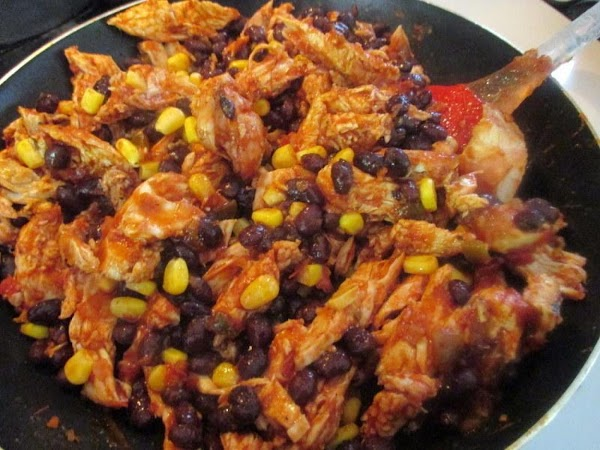 Place your shredded chicken, beans, taco seasoning, chili powder, corn and salsa in a...