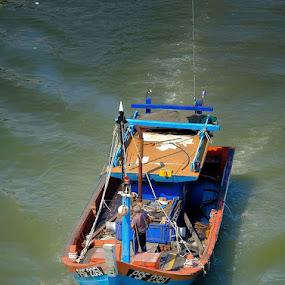 A Fisherman at Jetty Kuala Perlis, Malaysia by Adi Affendi - Transportation Boats