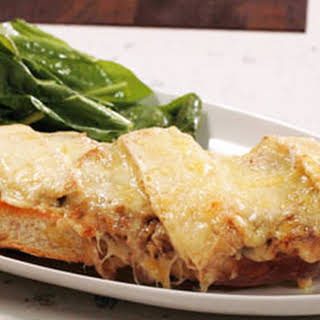 French Onion Soup Topped French Bread Pizzas and Salad with Dijon Vinaigrette.