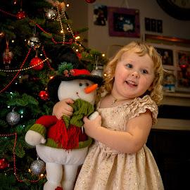 Iveta's Christmas friend  by Janis Ozols - Babies & Children Children Candids ( snowman, children, christmas tree, girl, christmas )
