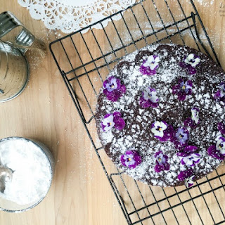 Single-Layer Chocolate Cake with Edible Flowers.
