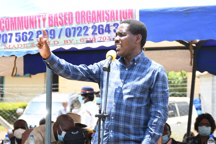 Agriculture CS Peter Munya address coffee farmers at Ekerenyo grounds on February 19.