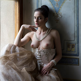 After the Ball by Alex Tsarfin - Nudes & Boudoir Artistic Nude ( look, model, nude, vintage, art, retro, beauty, portrait, eyes, renaissance, bracelet, pose, window, hands, female, dress, naked, woman, light, necklace )