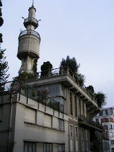 Photo: This unusual concrete tower (a water tank for exterior gardens) tops Hennebique House, which was built in the early 20th century to highlight the potential for concrete construction in residential buildings; a more complete history can be found here: http://parisisinvisible.blogspot.com/2011/09/concrete-chateau.html