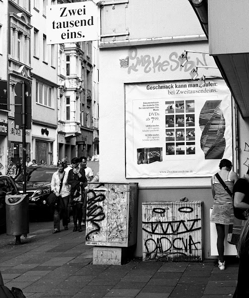 Photo: This is a bit of an insider joke, so please bear with me. During Charles Bukowski's (1920-1984) visit in Germany he made a stop in Cologne, this was in 1978. And at this very corner he was standing together with employees of his publisher. Every time I'm passing this corner at Cologne's Ehrenstraße I'm thinking of this important moment in literature history. :-) Now let's drink a beer to Hank. The only contemporary shot from 1978 that I could find is featured here (http://derstandard.at/2399077). Same place, different time.